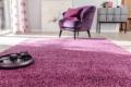 Jab Teppich mit lila Sessel
