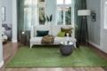 Jab Teppich grün mit Sofa