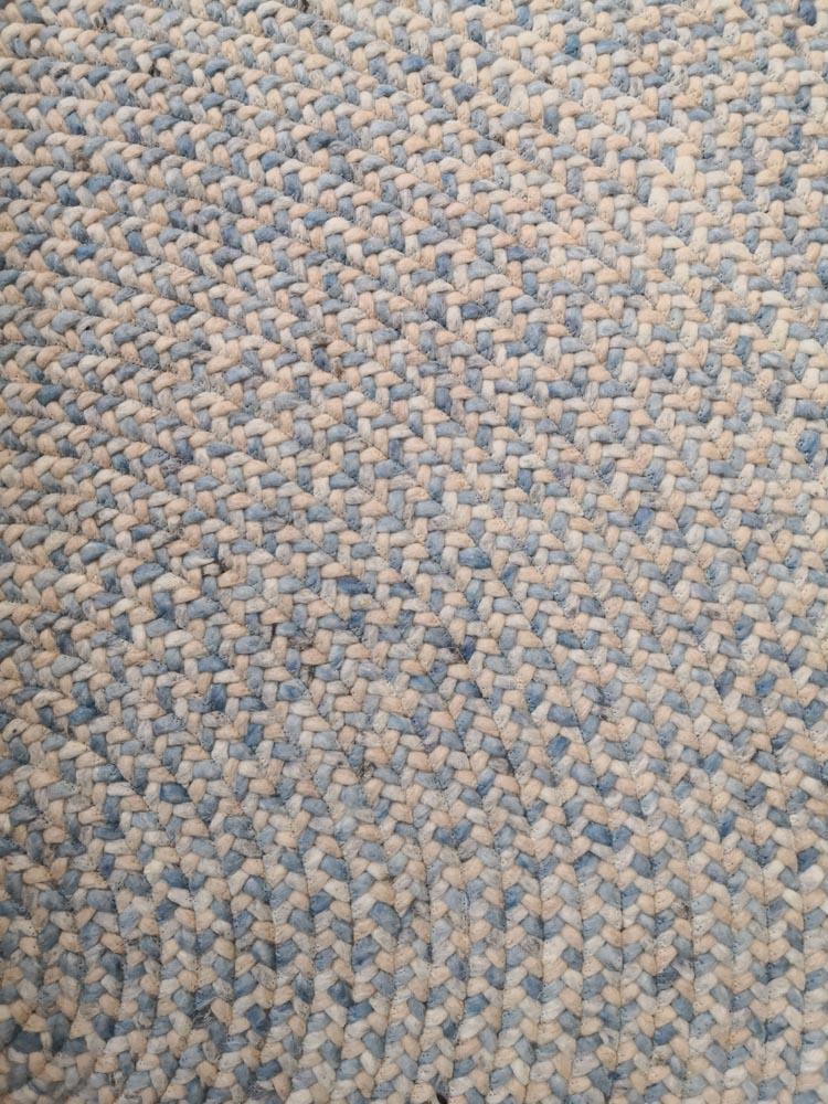 Auschnnitt runder Teppich geflochten
